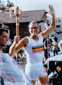 Al Dorman carries the Olympic torch
