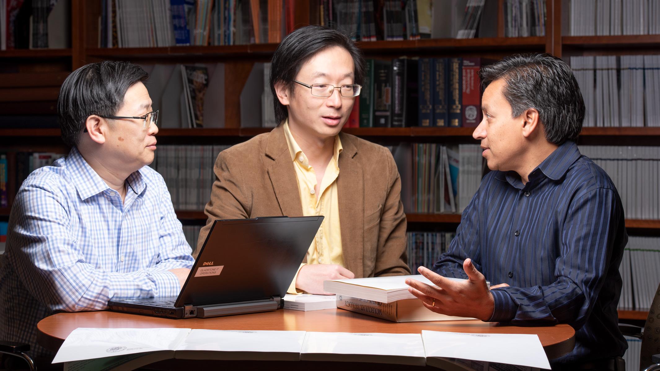 Gladstone investigators at a table speaking