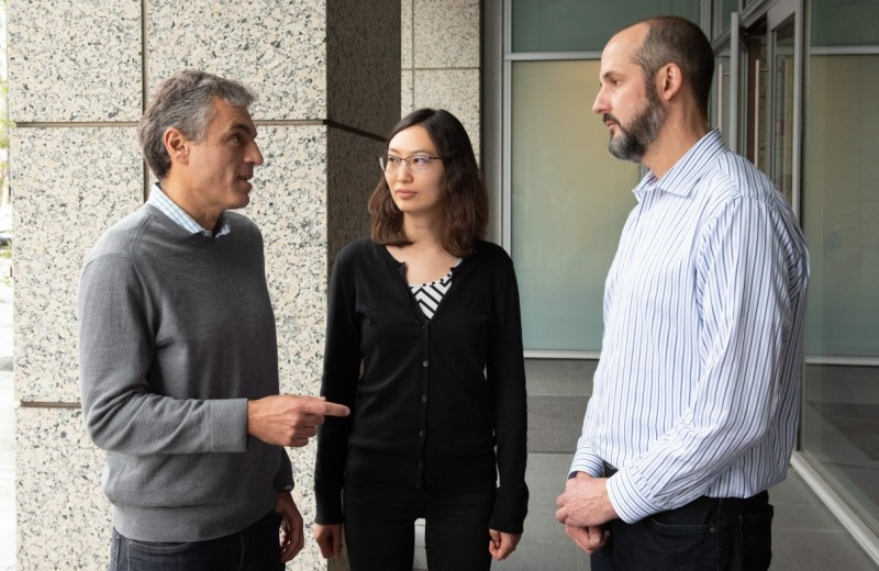 Jorge Palop talking to Keran Ma and Jesse Hanson outside the Gladstone building